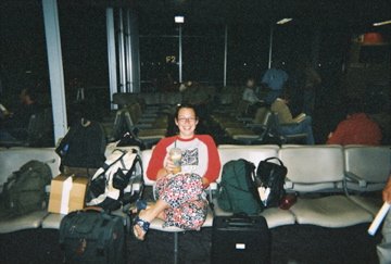 christa, drinking a starbucks coffee in an airport waiting to go to haiti